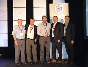 Award being given to Sterling and Shawn at the Dealer Principal meeting in Montreal
